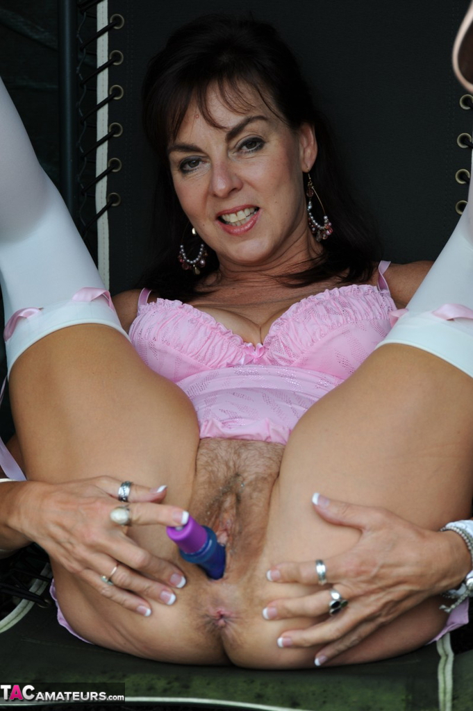 Mature UK Milf Georgie dildos her hairy pussy on the garden swing