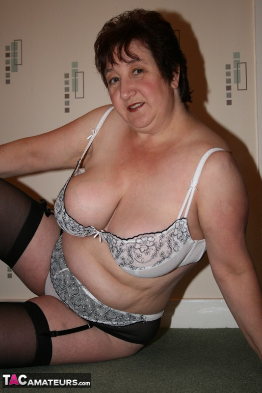 BBW housewife peels back her knickers and shows her fat juicy pussy on the stairs